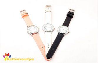 drie horloge met katten